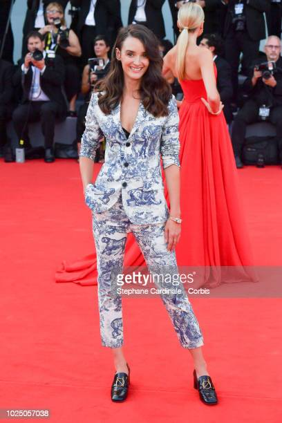Actress Charlotte Le Bon walks the red carpet ahead of the opening ceremony and the 'First Man' screening during the 75th Venice Film Festival at...