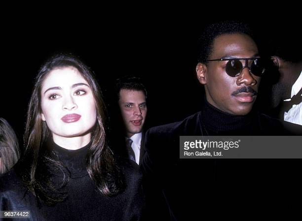 Actress Charlotte Lewis and actor Eddie Murphy attend the premiere of The Golden Child on December 11 1986 at the Loew's Astor Plaza Theater in New...