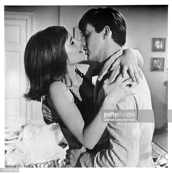 Actress Charlotte Rampling and actor Anton Rodgers on set of the movie Rotten to the Core in 1965