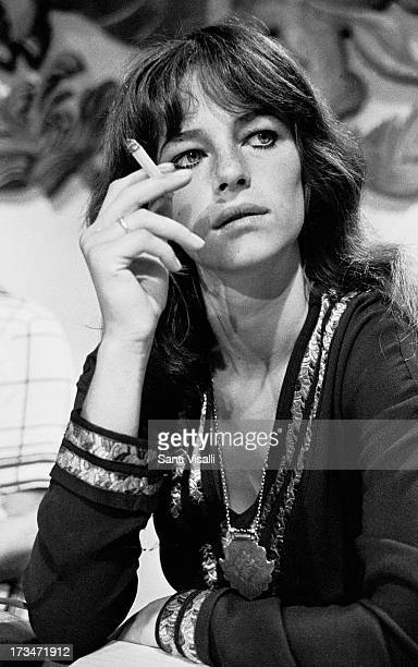 Actress Charlotte Rampling posing with a cigarette on April 201969 in Hamilton Bermuda