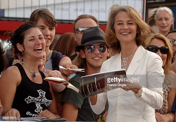 Actress Charlotte Rampling signs autographs for fans as she arrives for the premier of the film Vers Le Sud at the Palazzo del Cinema on the eighth...