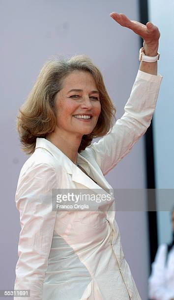 Actress Charlotte Rampling waves as she arrives for the premier of the film Vers Le Sud at the Palazzo del Cinema on the eighth day of the 62nd...