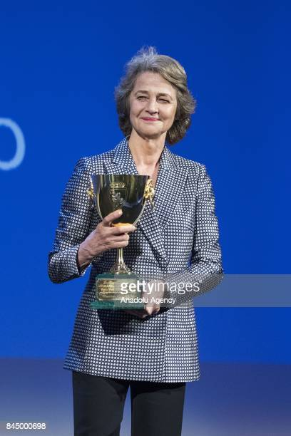 Actress Charlotte Rampling wins the Coppa Volpi for Best actress in the film 'Hannah' during Ceremony Awards of the 74th Venice International Film...