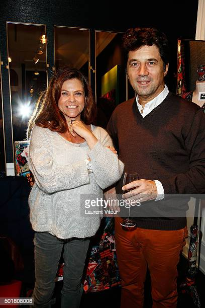 Actress Charlotte Valandrey and Actor Bruno Madinier attend 'Accords Croises' Anne Mondy's exhibition at Rue Bonaparte on December 17 2015 in Paris...