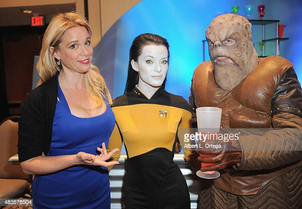 Actress Chase Masterson from 'Star Trek Deep Space Nine' poses with Cosplayer Joanie Brosas and Morn inside Quark's Bar at the 14th annual official...
