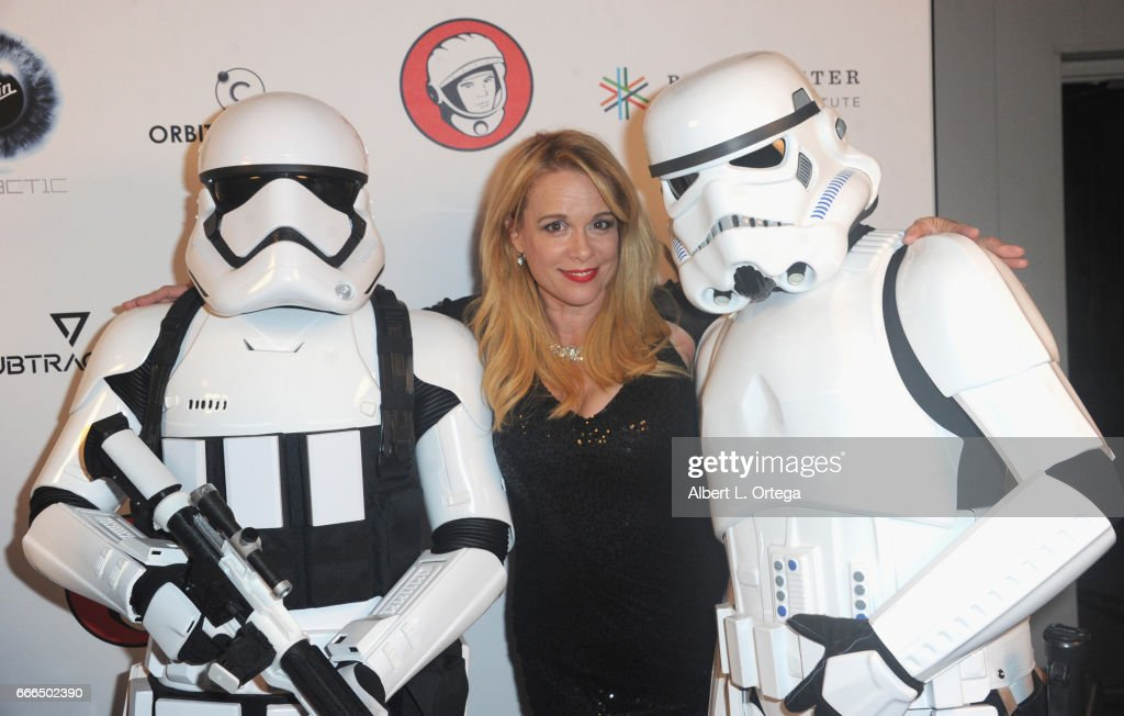 Actress Chase Masterson poses with Storm Troopers at Yuri's Night L.A. held on April 8, 2017 in Los Angeles, California.