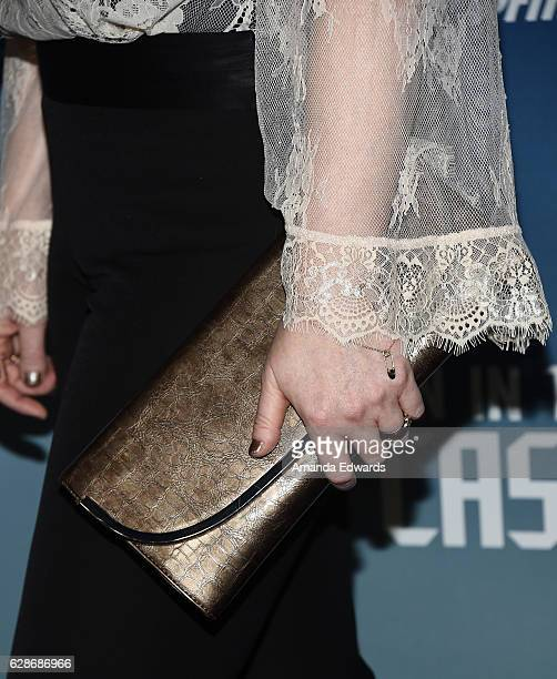 Actress Chelah Horsdal clutch detail arrives at the premiere of Amazon's Man In The High Castle Season 2 at the Pacific Design Center on December 8...