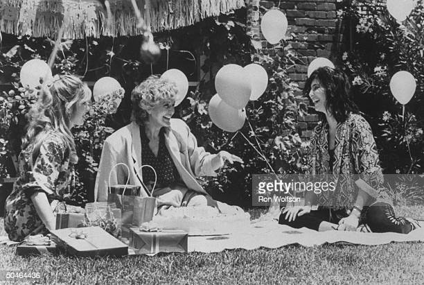 Actress Cher Bono w her mother Georgia Holt and an unident woman having a picnic