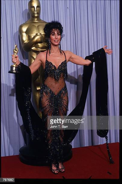 Actress Cher holds her Best Actress in a Leading Role Oscar for Moonstruck at the Academy Awards April 11 1988 in Los Angeles CA The Academy Awards...