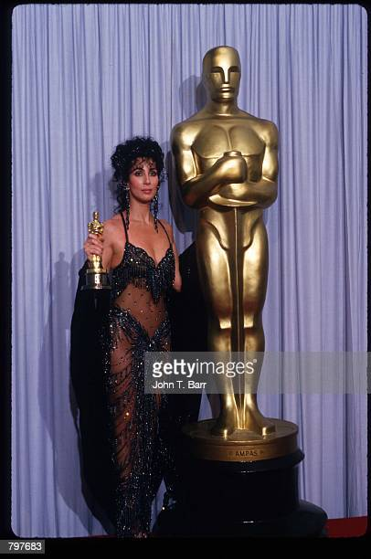 "Actress Cher holds her Best Actress in a Leading Role Oscar for ""Moonstruck"" at the Academy Awards April 11, 1988 in Los Angeles, CA. The Academy..."