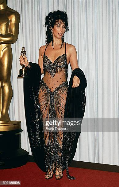 Actress Cher posing in the press room at the 1988 Academy Awards��This photo appears on page 55 in Frank Trapper's RED CARPET book
