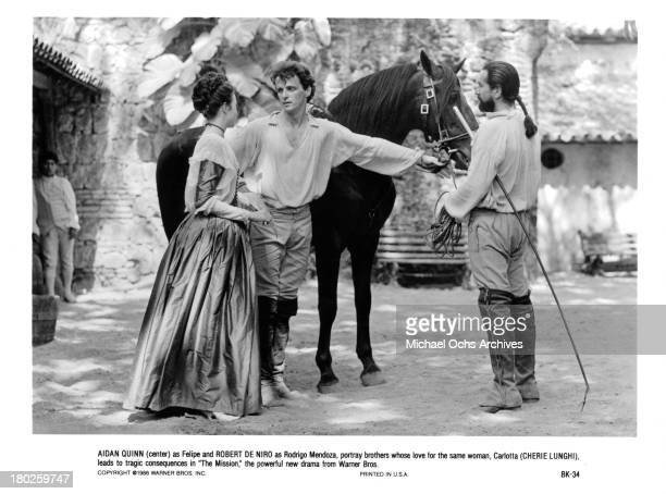 Actress Cherie Lunghi and actors Aidan Quinn and Robert De Niro on the set of Warner Bros movie The Mission in 1986