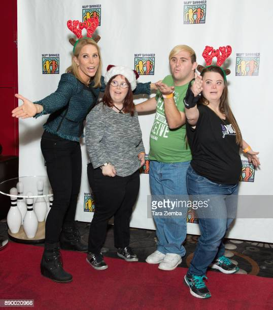 Actress Cheryl HInes tv personalities Rachel Osterbach Sean McElwee and Caley Versfelt attend Bowling For Buddies at PINZ Bowling Entertainment...