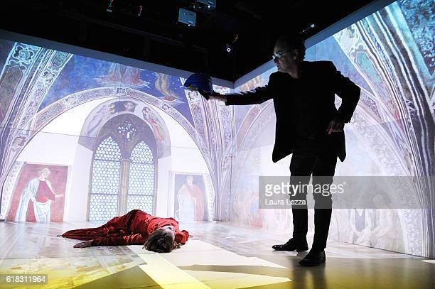 Actress Chiara Martini and Director of the Theatrical Academy in Florence Pietro Bartolini with a special helmet perform on stage during a rehearsal...