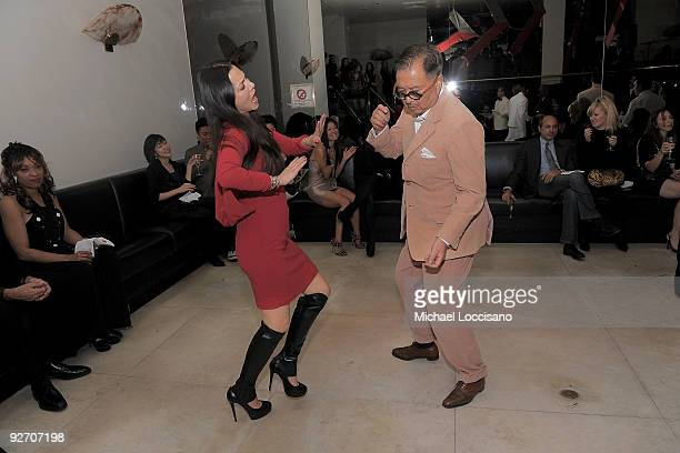 Actress China Chow and father restauranter Michael Chow dance during the Mr Chow 30th Anniversary Celebration at the Mr Chow on November 3 2009 in...