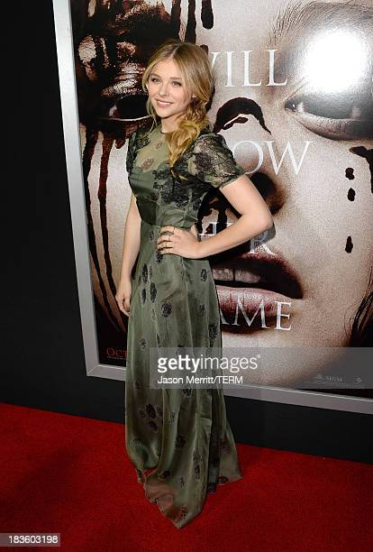 Actress Chloë Grace Moretz arrives at the premiere of MetroGoldwynMayer Pictures Screen Gems' Carrie at ArcLight Cinemas on October 7 2013 in...