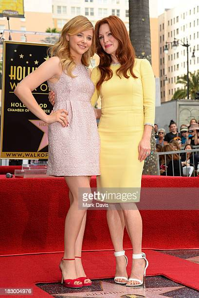 Actress Chloe Grace Moretz and actress Julianne Moore pose as Julianne Moore is honored with a star on the Hollywood Walk of Fame on October 3 2013...