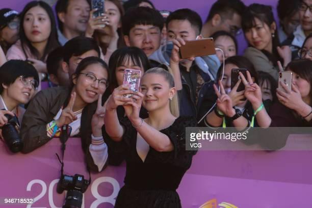 Actress Chloe Grace Moretz arrives at red carpet during the Opening Ceremony of 2018 Beijing International Film Festival on April 15 2018 in Beijing...