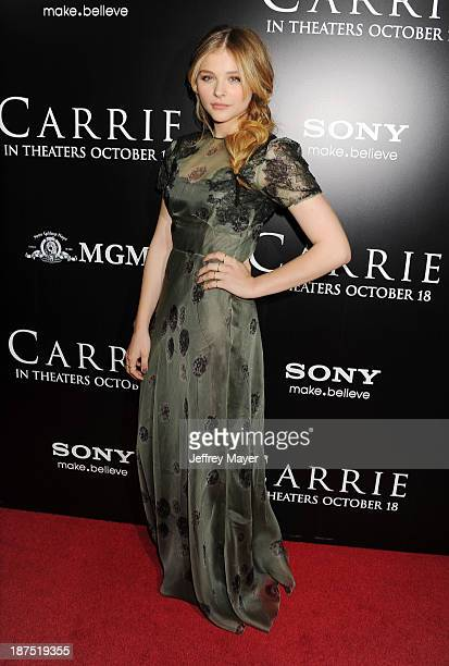 Actress Chloe Grace Moretz arrives at the Los Angeles premiere of Carrie at ArcLight Hollywood on October 7 2013 in Hollywood California