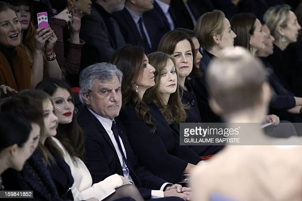 US actress Chloe Grace Moretz French actress Laetitia Casta Christian Dior CEO Sidney Toledano and his wife Katia French actress Isabelle Huppert US...