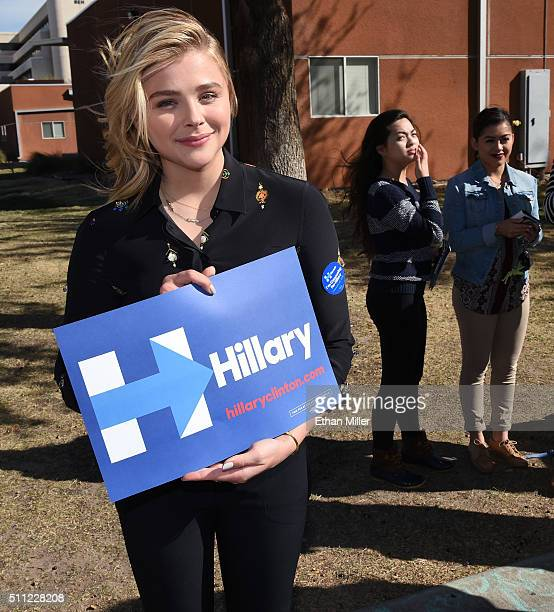 Actress Chloe Grace Moretz holds a campaign sign for Democratic presidential candidate Hillary Clinton as she campaigns for Clinton at UNLV on...