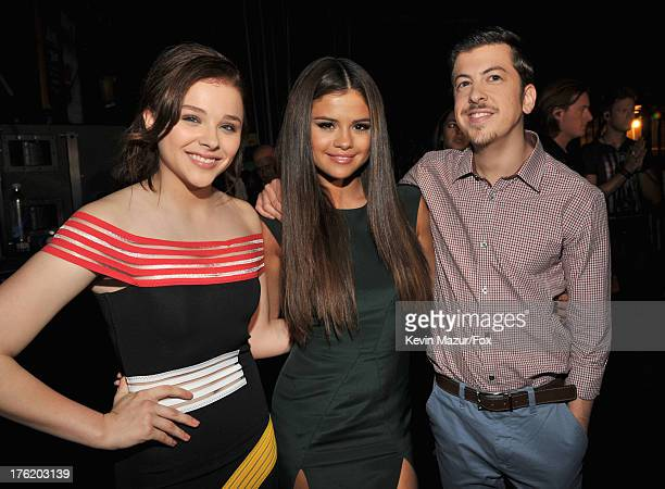 Actress Chloe Grace Moretz musician Selena Gomez and actor Christopher MintzPlasse attend the 2013 Teen Choice Awards at Gibson Amphitheatre on...