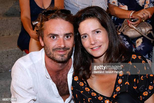 Actress Chloe Lambert and her companion Director Thibault Ameline attend the 'Georges and Georges' Theater play during the 31th Ramatuelle Festival...