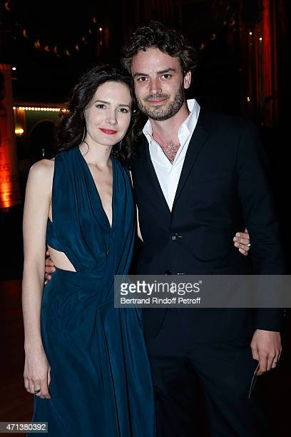 Actress Chloe Lambert and her husband producer Thibault Ameline attend the 27th 'Nuit Des Molieres' 2015. Held at Folies Bergere on April 27, 2015 in...