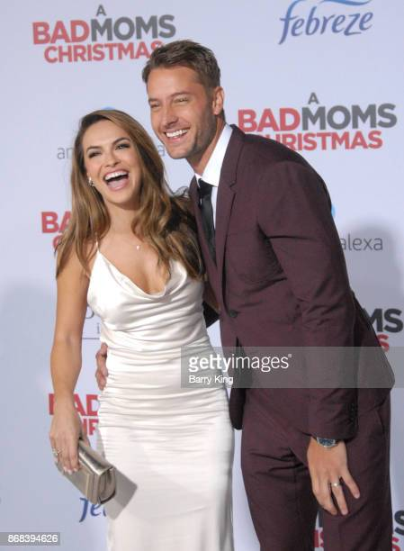 Actress Chrishell Stause and husband actor Justin Hartley attend the premiere of STX Entertainment's 'A Bad Mom's Christmas' at Regency Village...