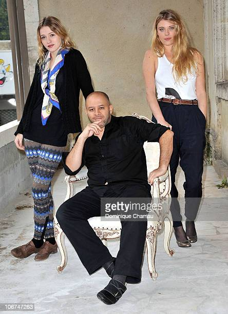 Actress Christa Theret Director Fouad Benhammou and actress Ornella Boule pose for the photocall of 'Le village des ombres' at hotel Renoir during...
