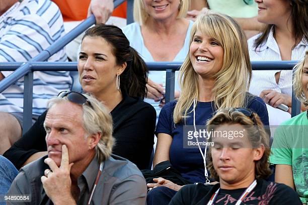 Actress Christie Brinkley right former tennis player Jennifer Capriati rear left and golfer Greg Norman left watch a men's semifinal match between...