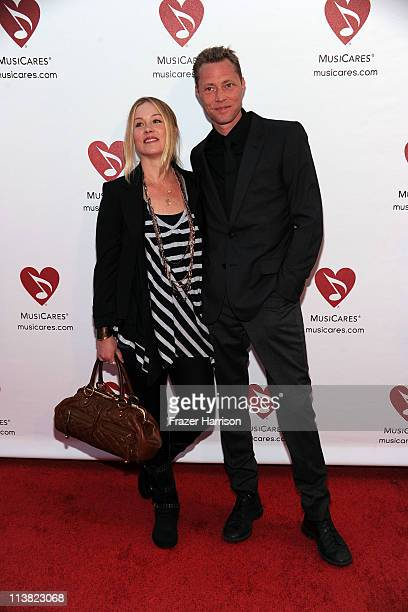 Actress Christina Applegate and fiance Martyn Lenoble arrives at the 7th Annual MusiCares MAP Fund Benefit at Club Nokia LA Live on May 6 2011 in Los...