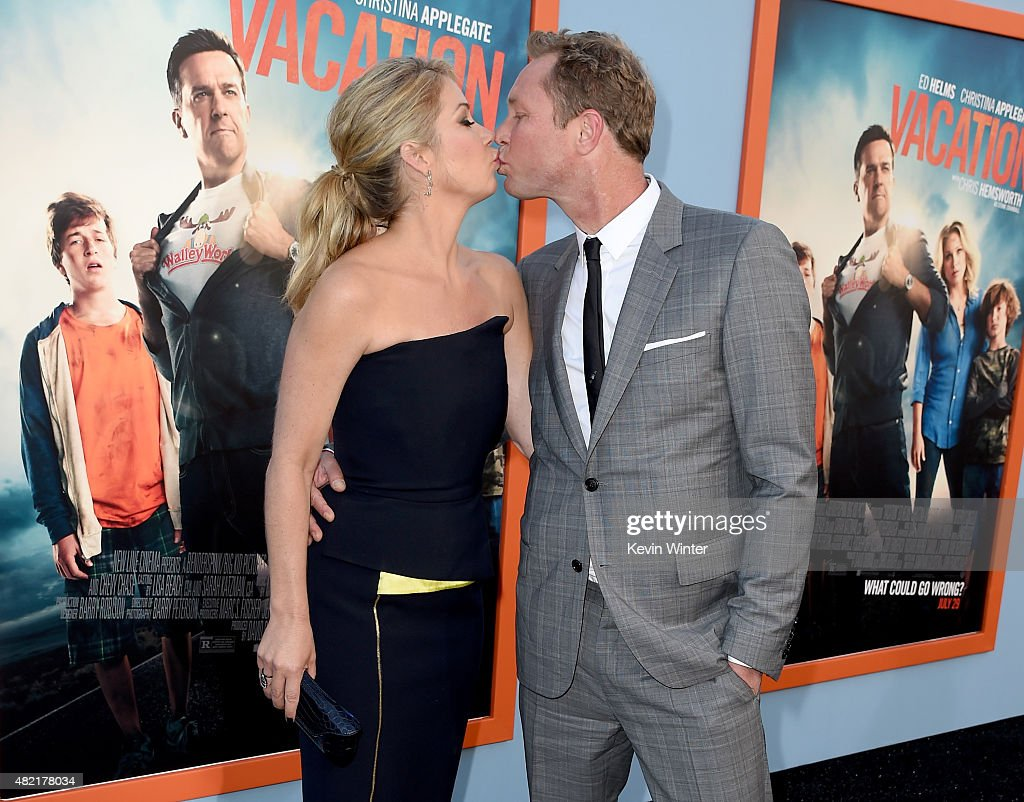 Actress Christina Applegate (L) and her husband musician Martyn LeNoble arrive at the premiere of Warner Bros. Pictures' 'Vacation' at the Village Theatre on July 27, 2015 in Los Angeles, California.