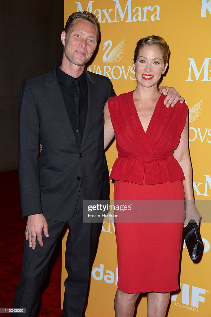 Actress Christina Applegate and musician Martyn LeNoble arrive at the 2012 Women In Film Crystal + Lucy Awards at The Beverly Hilton Hotel on June 12, 2012 in Beverly Hills, California.