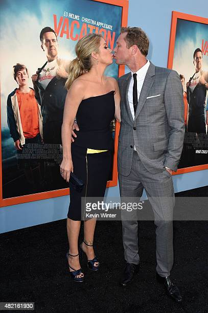Actress Christina Applegate and musician Martyn LeNoble attend the premiere of Warner Bros Pictures Vacation at Regency Village Theatre on July 27...