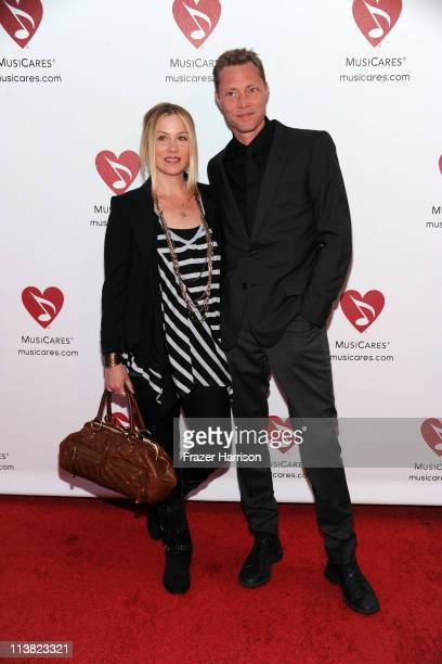 Actress Christina Applegate Martyn Lenoble arrive at the 7th Annual MusiCares MAP Fund Benefit at Club Nokia LA Live on May 6 2011 in Los Angeles...