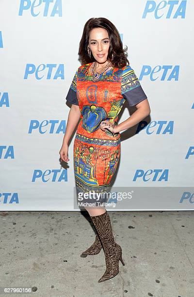 """Actress Christina De Rosa attends the unveiling of Jhene Aiko's """"Rather Go Naked Than Wear Fur"""" ad at the opening night of PETA's """"Naked Ambition:..."""