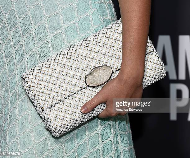 """Actress Christina DeRosa, clutch detail, arrives at the premiere of Lionsgate's """"American Pastoral"""" on October 13, 2016 in Beverly Hills, California."""