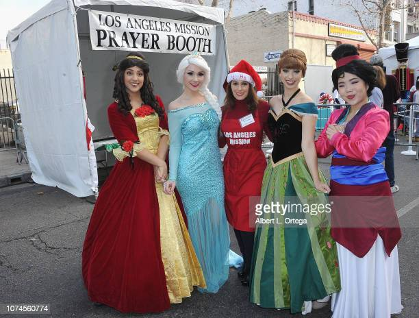 Actress Christina DeRosa poses with Disney Princesses at the Los Angeles Mission Christmas On Skid Row held at Los Angeles Mission on December 21...