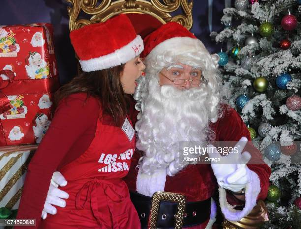 Actress Christina DeRosa whispers into Santa Claus' ear at the Los Angeles Mission Christmas On Skid Row held at Los Angeles Mission on December 21...