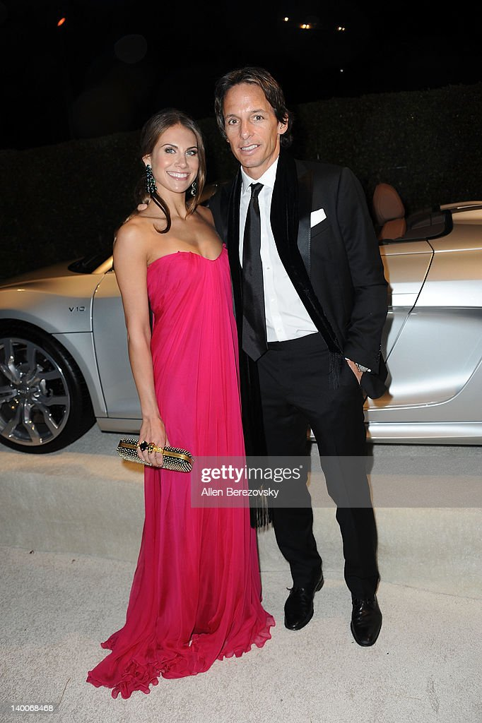 Actress Christina Hale and a guest arrive at Audi Arrivals at 20th annual Elton John AIDS Foundation Academy Awards viewing party on February 26, 2012 in Beverly Hills, California.