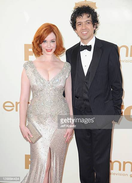 Actress Christina Hendricks and actor Geoffrey Arend arrive at the 63rd Primetime Emmy Awards at Nokia Theatre LA Live on September 18 2011 in Los...