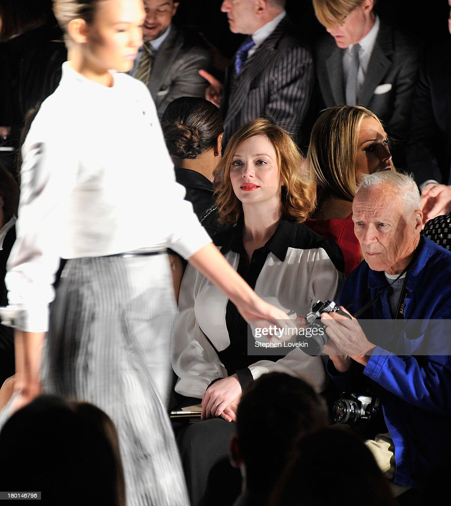 Actress Christina Hendricks (L) and photographer Bill Cunningham attend the Carolina Herrera fashion show during Mercedes-Benz Fashion Week Spring 2014 at The Theatre at Lincoln Center on September 9, 2013 in New York City.