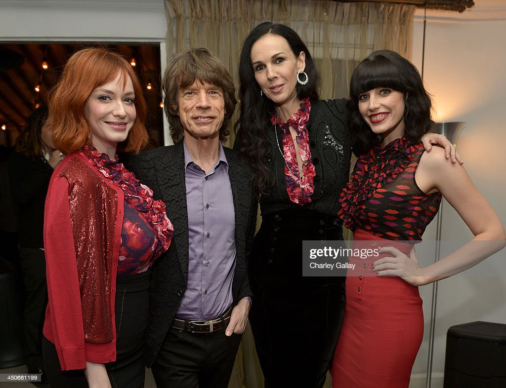 Actress Christina Hendricks, singer Mick Jagger, fashion designer L'Wren Scott, and actress Jessica Pare attend the launch celebration of the Banana Republic L'Wren Scott Collection hosted by Banana Republic, L'Wren Scott and Krista Smith at Chateau Marmont on November 19, 2013 in Los Angeles, California.