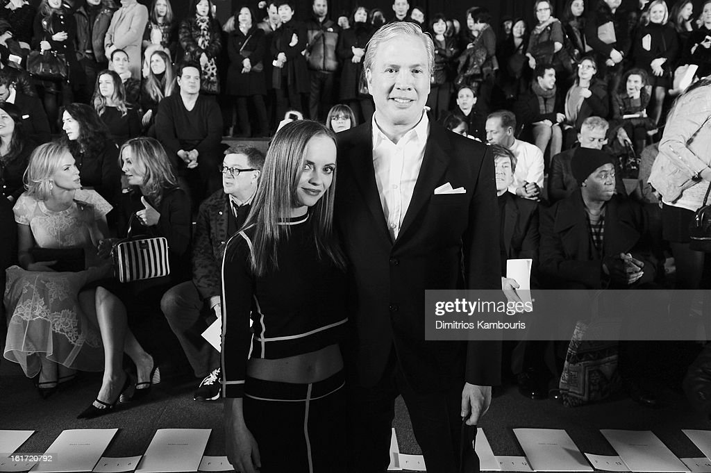 Actress Christina Ricci and CEO of Marc Jacobs Robert Duffy attend the Marc Jacobs Collection Fall 2013 fashion show during Mercedes-Benz Fashion Week at New York Armory on February 14, 2013 in New York City.