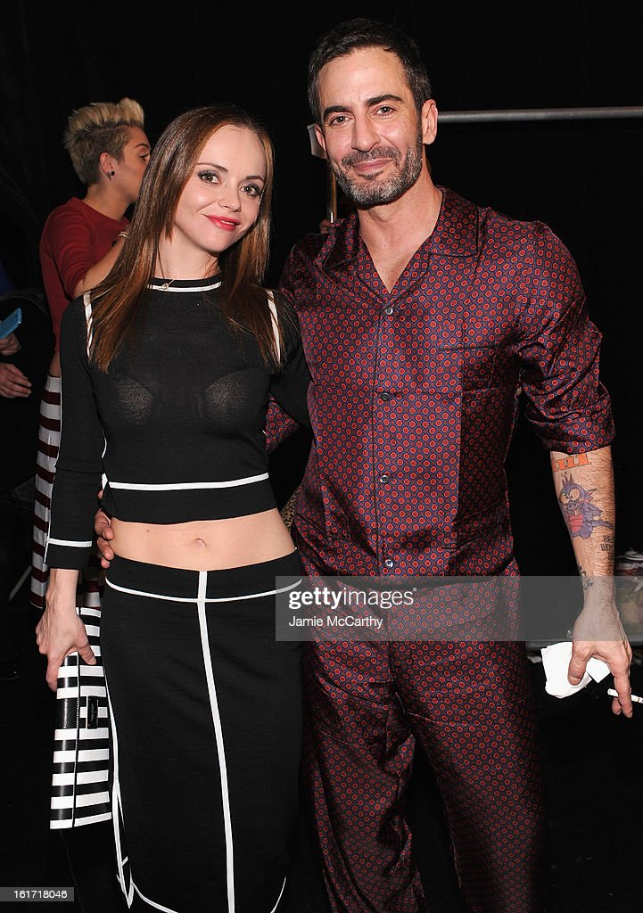 Actress Christina Ricci (L) and designer Marc Jacobs backstage at the Marc Jacobs Collection Fall 2013 fashion show during Mercedes-Benz Fashion Week at New York Armory on February 14, 2013 in New York City.