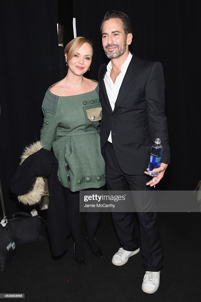 Actress Christina Ricci (L) and designer Marc Jacobs pose backstage at the Marc Jacobs fashion show during Mercedes-Benz Fashion Week Fall 2015 at Park Avenue Armory on February 19, 2015 in New York City.