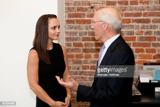 Actress Christina Ricci , national spokesman for Rape, Abuse and Incest National Network, talks with Frederick Arnold, chairman of RAINN's Board of...