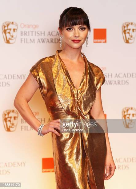 Actress Christina Ricci poses in the press room during the Orange British Academy Film Awards 2012 at the Royal Opera House on February 12 2012 in...