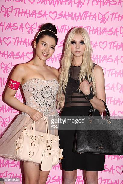 Actress Christine Kuo and actress Taylor Momsen attend Samantha Thavasa store opening ceremony at SOGO Causeway Bay on September 27 2012 in Hong Kong...